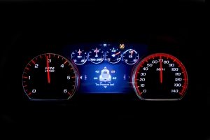 Modern light car mileage (dashboard, milage) isolated on a black background. New display of a modern car. Tire pressure - TSI.