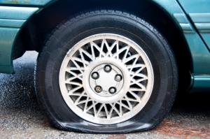 Flat tire on a blue car